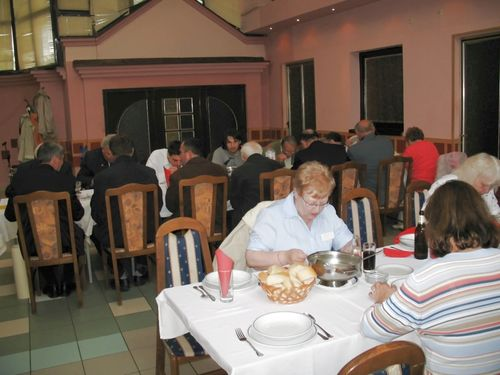 "Picture 19 – . . . with the table of the ""officials"" from the OA Jarek and from the community Bački Jarak and Temerin."